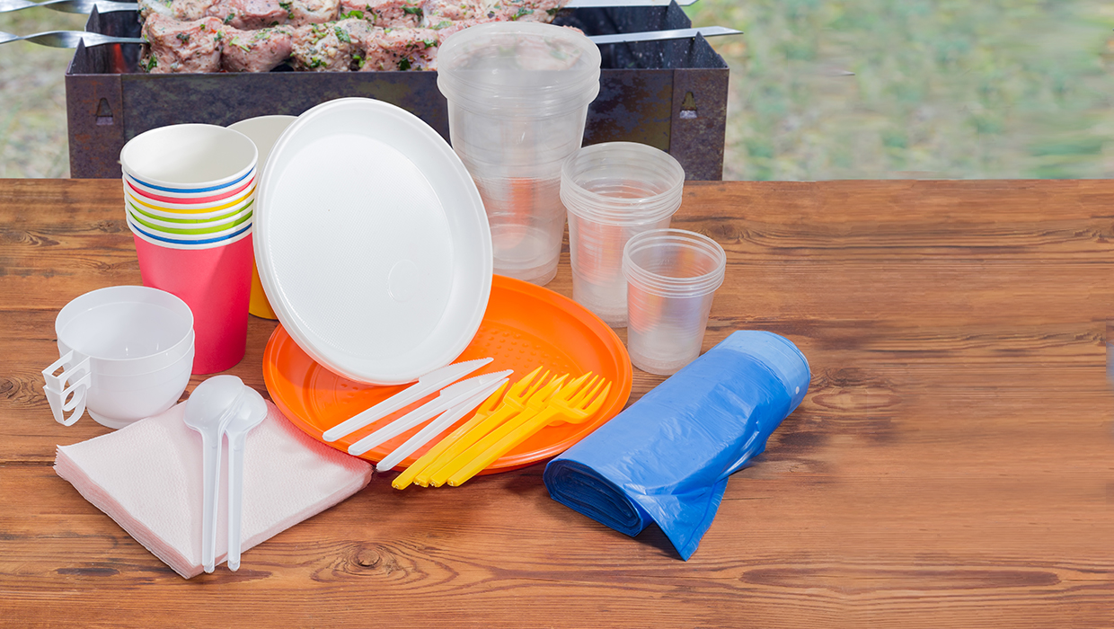 An assortment of plastic ware, cups, plates and forks